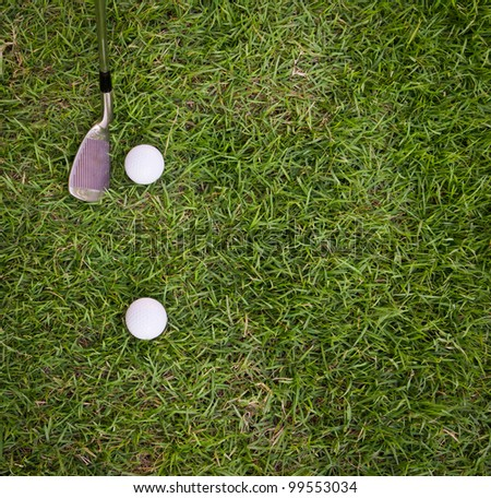golf ball and iron on  grass - stock photo