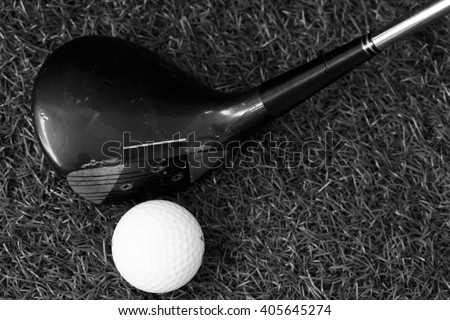 Golf ball and old golf club in black and white tone. - stock photo