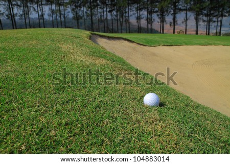 Golf ball and sand hole - stock photo