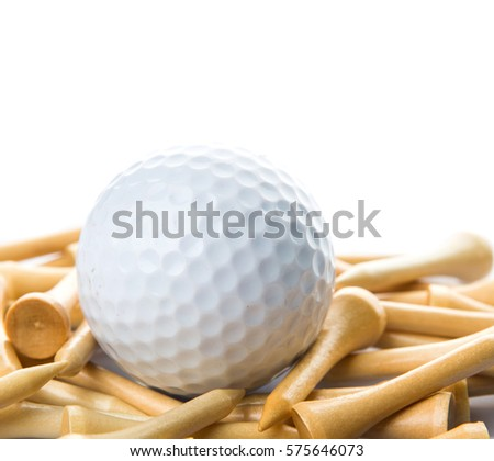 Golf ball and wood tee over white background