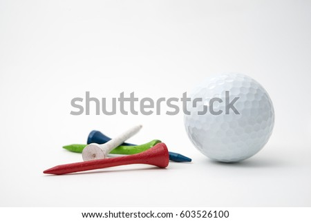 golf ball and wood tees