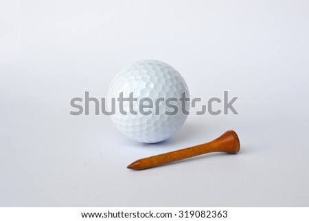 golf ball and wooden tee, sport time