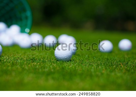 Golf ball  basket grass equipment leisure activity - stock photo