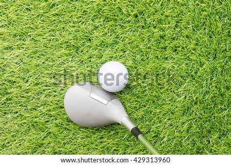 Golf ball before hitting with golf club on course