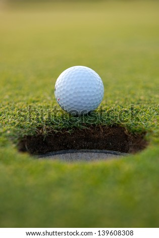 Golf ball close the cup - stock photo