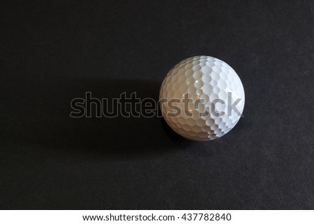 Golf ball closeup on black background