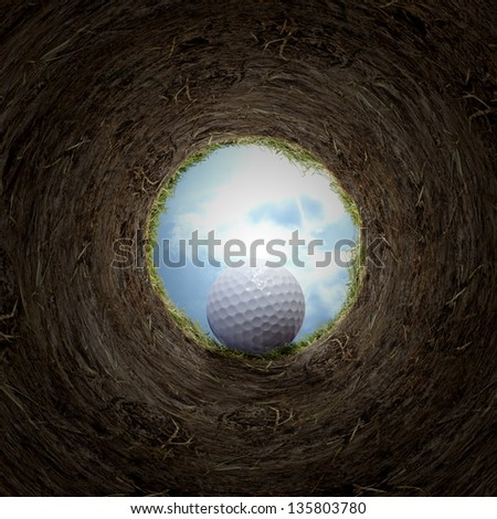 Golf ball falling in cup. - stock photo