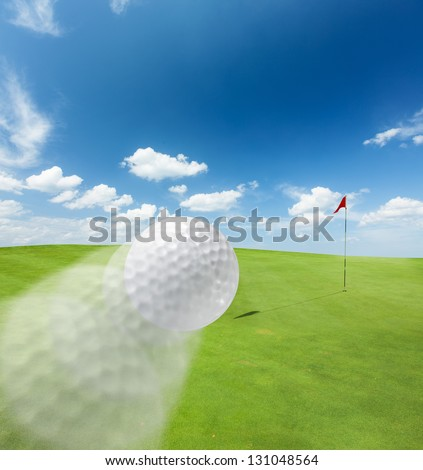 Golf Ball flying in the field