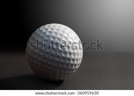 Golf ball in dark background  - stock photo