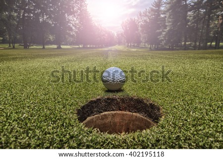 Golf ball in green - stock photo