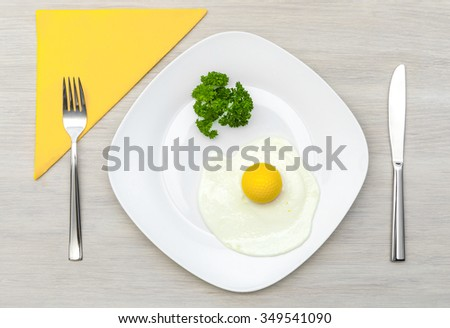 Golf ball in place of poached egg yolk served for a breakfast