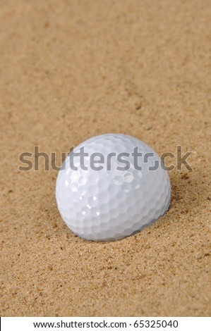 Golf ball in sand - stock photo