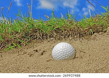 golf ball in sand banger - stock photo