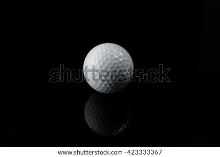 Golf ball isolated on black background