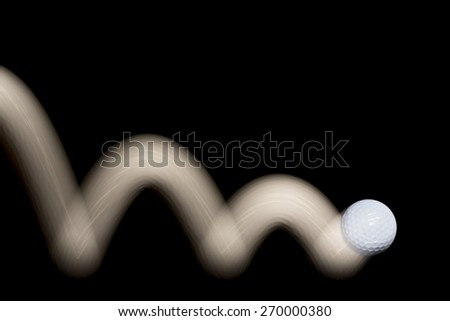 Golf ball jumping with motion trail isolated on black background, empty copy space for text. - stock photo