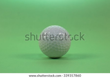golf ball on a green background - stock photo