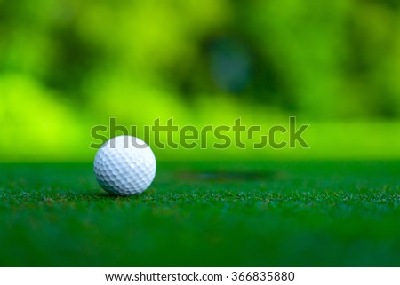 Golf ball on a lawn - stock photo