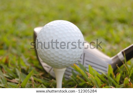 Golf ball on a tee and driver