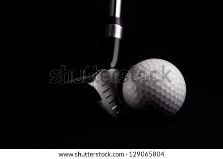 Golf ball on black background - stock photo