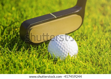 golf ball on course about to be shot - stock photo