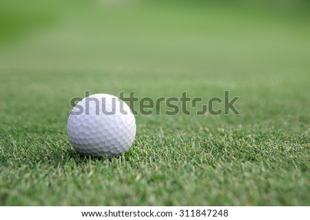 Golf ball on fairway,atmosphere morning,there is space on the left and right for adding text.