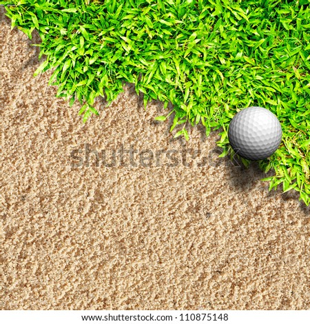 Golf ball on grass and sand - stock photo