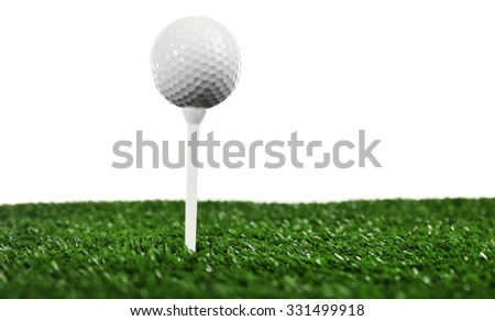 Golf ball on grass isolated on white - stock photo