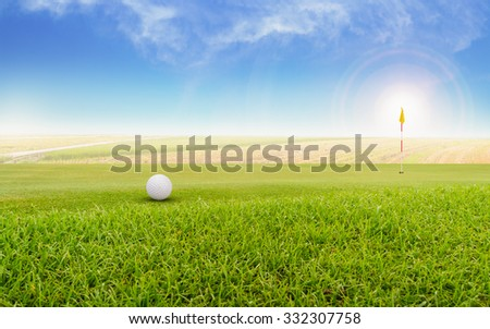 Golf ball on green. Foggy on a golf course. - stock photo