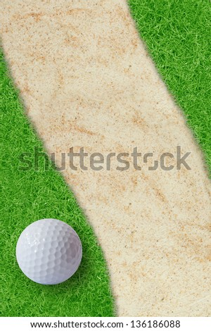 Golf ball on green grass and sand. - stock photo