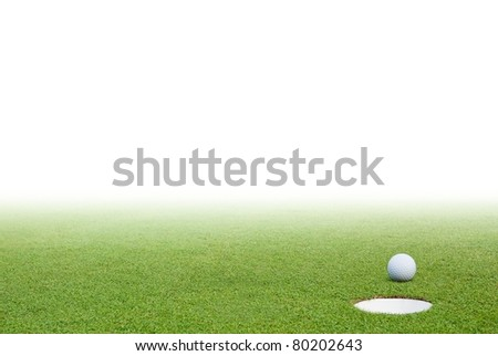 Golf ball on green grass and white background - stock photo