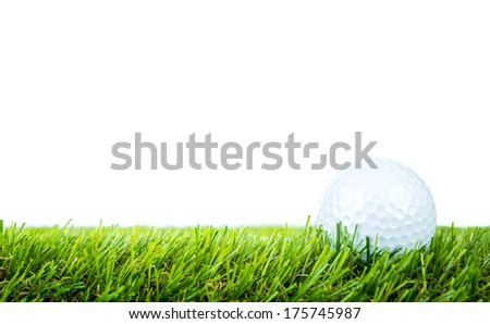 Golf ball on green grass over white background