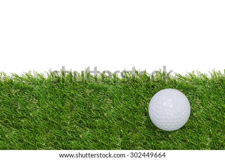 Golf ball on green grass with white area for copy space and clipping path. - stock photo