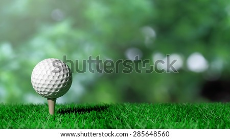 Golf ball on green turf and green background - stock photo