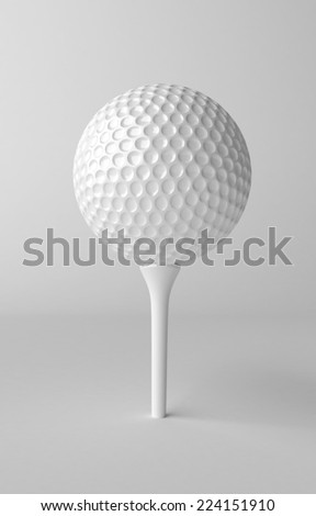 Golf ball on grey background - stock photo