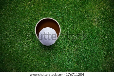 golf ball on lip of hole . - stock photo