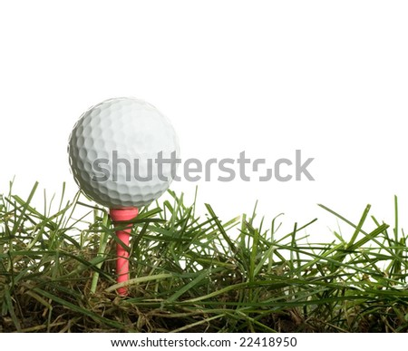 Golf ball on Pink Tee in green grass