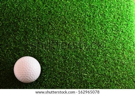 Golf Ball on putting green. - stock photo