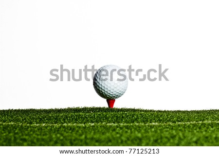 Golf Ball on Red Tee in Artificial Grass - stock photo