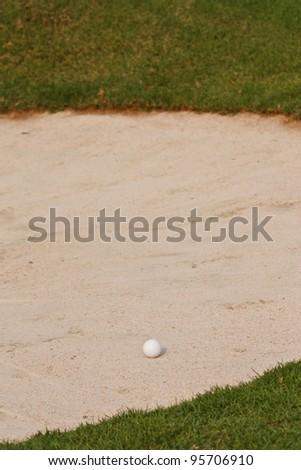 Golf ball  on sand bunker - stock photo