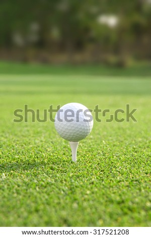 Golf ball on tee,atmosphere morning,There is space on the top and below for adding text.