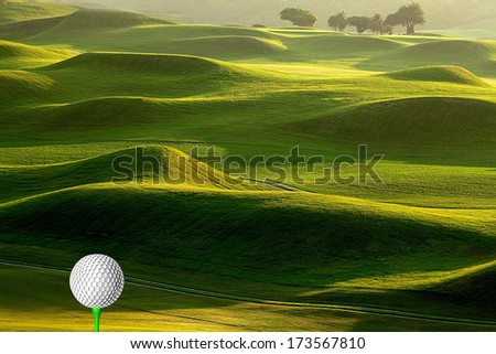 Golf ball on tee for adv or others purpose use - stock photo