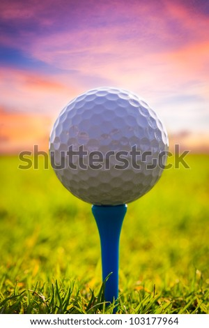 Golf ball on tee. Green grass - stock photo
