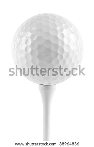 golf ball on tee in front of white background - stock photo