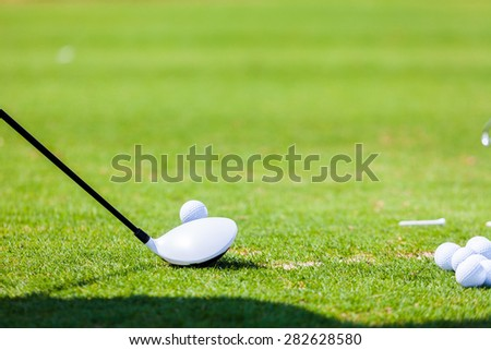Golf ball on tee Ready to Hit - stock photo