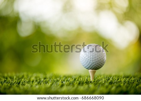 golf ball on tee ready to play