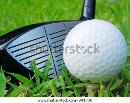 Golf ball on tee with club - stock photo