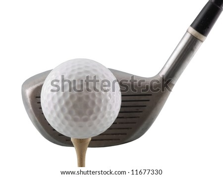 Golf ball on tee with club behind - stock photo
