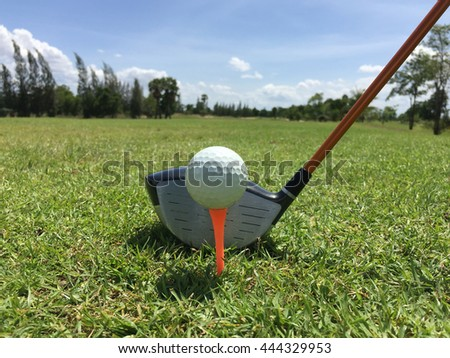 golf ball on tee with  driver club