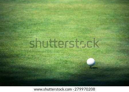 Golf ball on the green golf course - stock photo