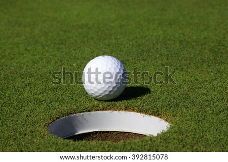 golf ball on the lawn, closeup of photo - stock photo